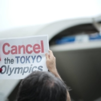 Protesters called for the Tokyo Games to be canceled during a demonstration Friday at Komazawa Olympic Park, where a ceremony was held to kick off the last stretch of the torch relay.   RYUSEI TAKAHASHI