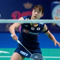 Badminton player Nozomi Okuhara, seen during a match in 2020, said not having fans at the Tokyo Olympics will not alter her focus. | REUTERS