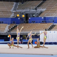 Japan's rhythmic gymnastics team competes in an empty arena during an Tokyo Olympic test event in May. | KYODO