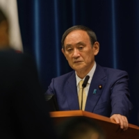 Prime Minister Yoshihide Suga during a news conference on Thursday in Tokyo.    BLOOMBERG