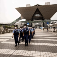 Police officers walk around the grounds of Tokyo Big Sight, the site of the International Broadcast Centre for the Tokyo Games, on Friday.    AFP-JIJI
