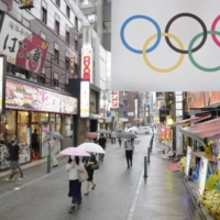 Tokyo's Shimbashi district on Friday. A group of citizens in Japan sought a court injunction on Friday to halt the upcoming Tokyo Olympics and Paralympics.    KYODO