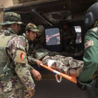 Afghan National Army soldiers load a simulated casualty onto a Black Hawk helicopter during a casualty evacuation drill at Camp Shorabak in Helmand Province, Afghanistan, in July 2018.     U.S. MARINE CORPS / VIA REUTERS