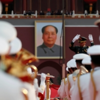 Military band members practice before the event marking the 100th founding anniversary of the Communist Party of China, in front of a portrait of late Chinese chairman Mao Zedong on Beijing's Tiananmen Square on July 1.   REUTERS