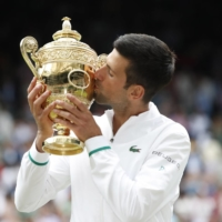 Serbia's Novak Djokovic celebrates after winning the Wimbledon final against Italy's Matteo Berrettini at the All England Lawn Tennis and Croquet Club in London on Sunday. | REUTERS