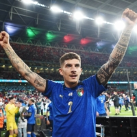 Italy's Giovanni Di Lorenzo celebrates after winning Euro 2020 in a penalty shootout at Wembley Stadium in London on Sunday.   POOL / VIA REUTERS