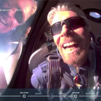 Billionaire Richard Branson reacts on board Virgin Galactic's passenger rocket plane VSS Unity after reaching the edge of space above Spaceport America near Truth or Consequences, New Mexico, on Sunday in a still image from video.     | VIRGIN GALACTIC / VIA REUTERS.
