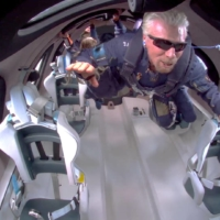 Billionaire Richard Branson floats in zero gravity on board Virgin Galactic's passenger rocket plane VSS Unity after reaching the edge of space above Spaceport America near Truth or Consequences, New Mexico, on Sunday in a still image from video. | VIRGIN GALACTIC / VIA REUTERS.