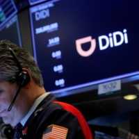 A trader works during the IPO for Chinese ride-hailing company Didi Global Inc. on the New York Stock Exchange floor on June 30. | REUTERS