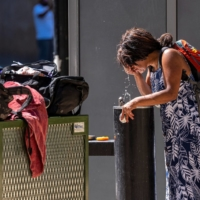 A resident cools off during a heat wave in Sacramento, California, on Thursday. | BLOOMBERG