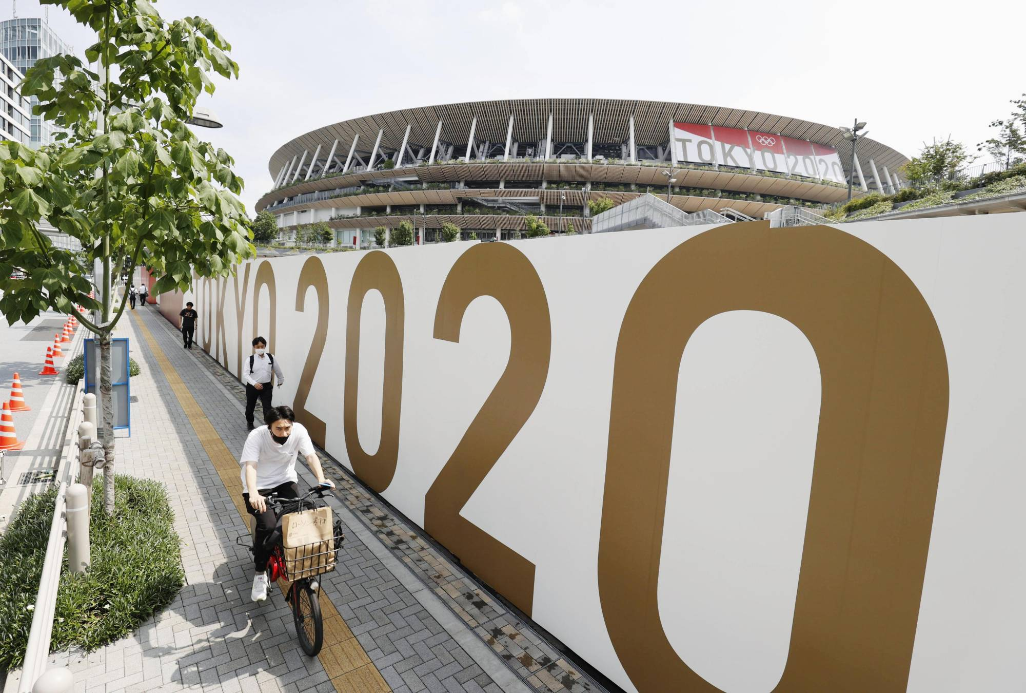 The National Stadium in Tokyo on Monday. Declaring the emergency in Tokyo was an unexpected about-face from the Suga administration.   KYODO