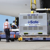 Workers unload AstraZeneca COVID-19 vaccines shipped from Japan at at Taoyuan International Airport in Taiwan last week. | TAIWAN CENTERS FOR DISEASE CONTROL / VIA REUTERS