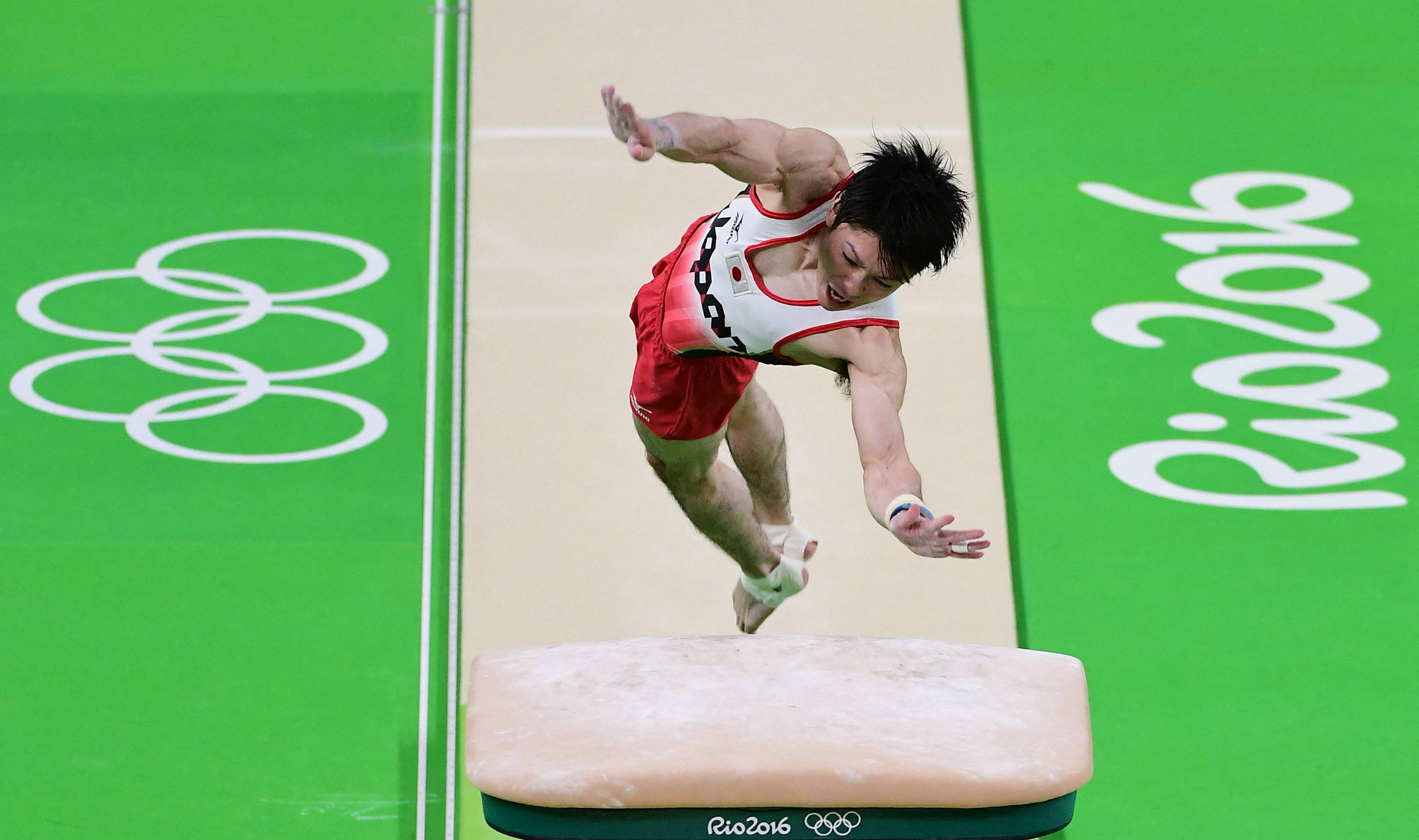 Kohei Uchimura competes in the vault event in the men's team final for artistic gymnastics during the 2016 Olympic Games in Rio de Janeiro. | AFP-JIJI