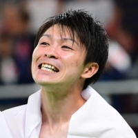 Kohei Uchimura celebrates after winning the men's individual all-around final in artistic gymnastics during the 2016 Olympic Games in Rio de Janeiro.  | AFP-JIJI