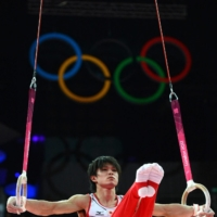 Gymnast Kohei Uchimura performs on the rings during the men's individual all-around competition in the artistic gymnastics event at the London Olympic Games in 2012. | AFP-JIJI
