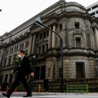 BOJ will offer cautiously upbeat view as COVID-19 curbs weigh, say sources
