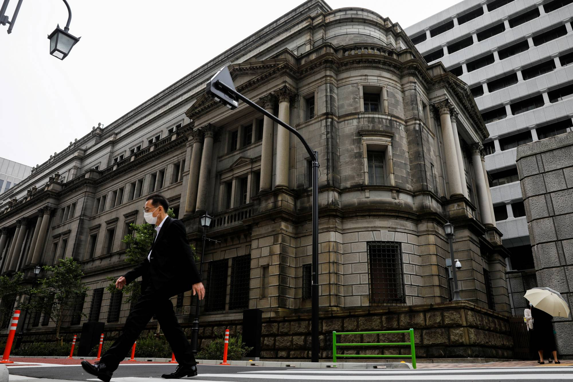 The Bank of Japan will likely offer a cautiously optimistic view of the economy in fresh quarterly projections due on Friday.   REUTERS