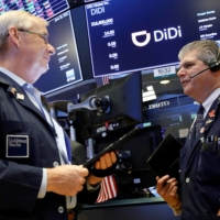 Traders work during the IPO for Chinese ride-hailing company Didi Global Inc. at the New York Stock Exchange on June 30.   | REUTERS