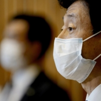 Yasutoshi Nishimura has said that pressure is needed to ensure cooperation in the government's attempts to rein in the spread of the coronavirus. | KYODO