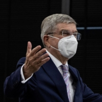 International Olympic Committee chief Thomas Bach gestures as he arrives at a meeting with Tokyo 2020 head Seiko Hashimoto in Tokyo on Tuesday.   POOL / VIA AFP-JIJI