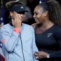 Serena Williams comforts Naomi Osaka after the crowd booed during the trophy ceremony following the women's final of the 2018 U.S. Open tennis tournament in New York. | ROBERT DEUTSCH / USA TODAY / VIA REUTERS