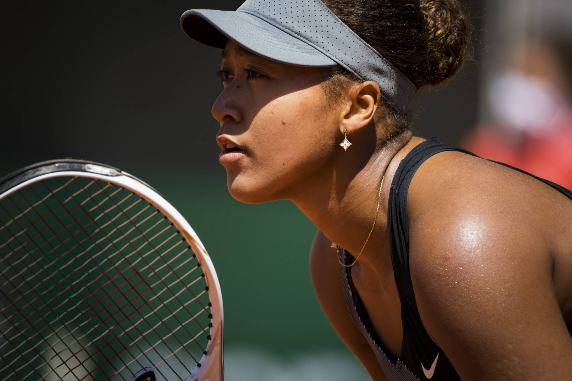 Naomi Osaka during her first round match at the French Open in Paris in May.  | PETE KIEHART / THE NEW YORK TIMES