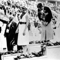 Maehata Hideko bows on the podium after winning a gold medal in the 200-meter breaststroke at the 1936 Berlin Olympics. The swimmer became Japan's first female gold medalist. | KYODO