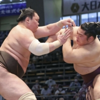 Hakuho (left) has blown away all talk of retirement and looks to be in his best form in years. | KYODO