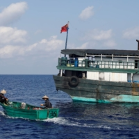 Chinese fishermen head to the disputed Scarborough Shoal in the South China Sea in April 2017. | REUTERS