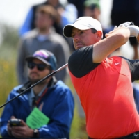 Northern Ireland's Rory McIlroy watches his drive from the 7th tee during a practice round for the British Open, in Sandwich, England, on Tuesday.  | AFP-JIJI