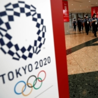 The Refugee Olympic Team has delayed its departure to Japan after an official with the delegation tested positive for COVID-19. | REUTERS