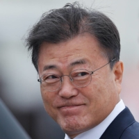 Japan will welcome South Korea's Moon for Olympics visit, ruling party says