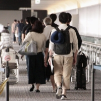 Japanese expats return from virus-hit Indonesia on chartered plane