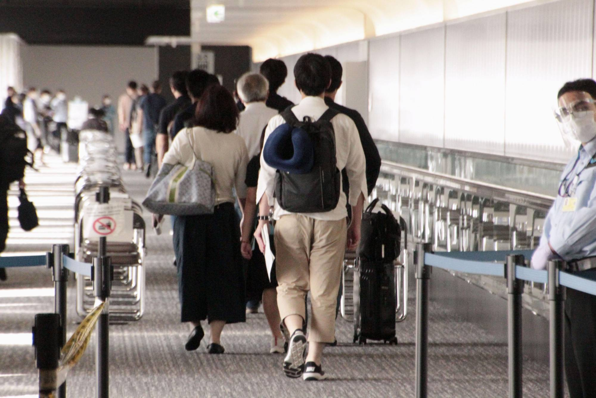 Shimizu Corp. workers and their family members arrive at Narita Airport on Thursday from Indonesia amid a surge of highly contagious delta coronavirus variant cases in the Southeast Asian country.   KYODO