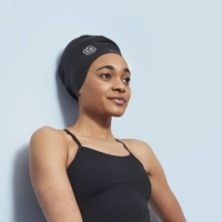 Alice Dearing, the first Black female swimmer to represent Britain at the Olympics, models the Soul Cap. | LUKE HUTSON FLYNN / VIA THE NEW YORK TIMES