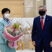 Thomas Bach (right), president of the International Olympic Committee, meets with  Tokyo Gov. Yuriko Koike in Tokyo on Thursday.    BLOOMBERG