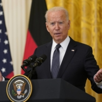 U.S. President Joe Biden holds a news conference with Angela Merkel, Germany's chancellor, at the White House in Washington on Thursday. | CNP / VIA BLOOMBERG