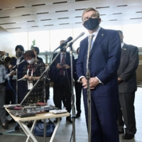International Olympic Committee head Thomas Bach speaks to reporters at the Prime Minister's Office on Wednesday after meeting Prime Minister Yoshihide Suga. | KYODO