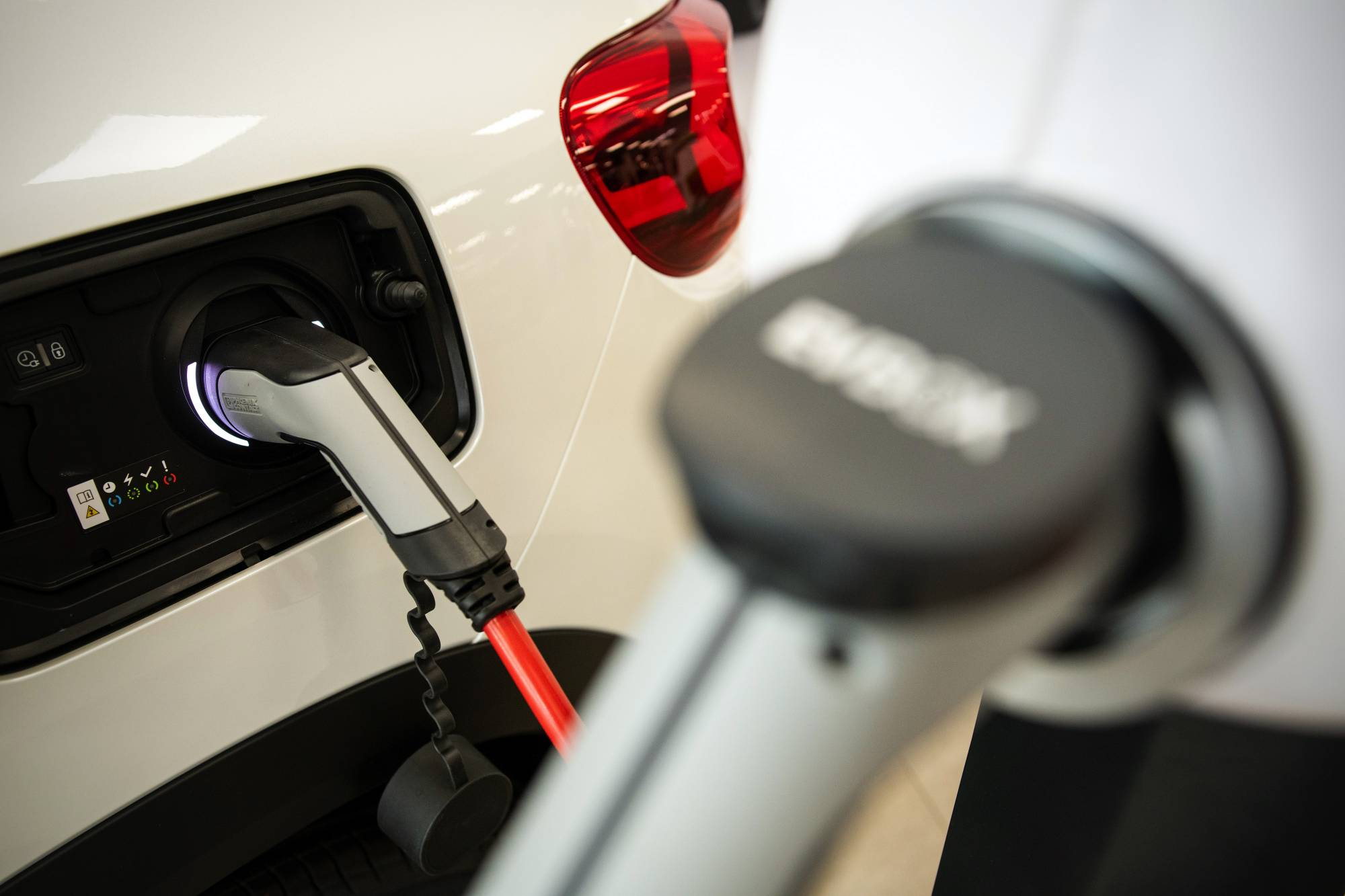 A Citroen C5 Aircross hybrid sports utility vehicle charges at a Citroen automobile showroom in Paris on Thursday. The EU on Wednesday laid out proposals that would consign the internal combustion engine to history. | BLOOMBERG