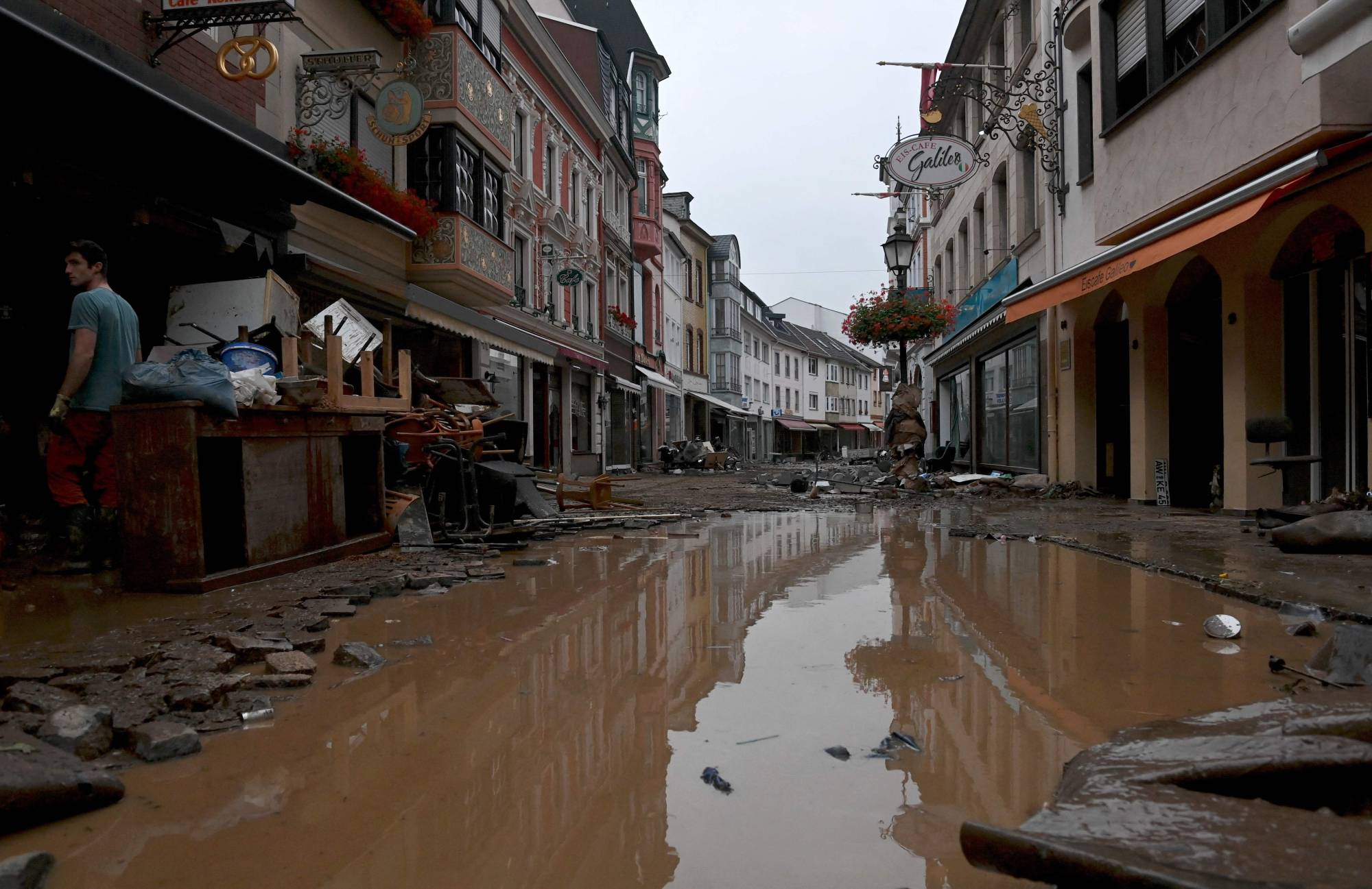 A flooded street in Ahrweiler-Bad Neuenahr, Germany, on Thursday. Voter surveys across Europe — which this week suffered deadly flash floods after record rainfall that some officials linked to global warming — show that climate change is a growing preoccupation among many of its citizens. | AFP-JIJI