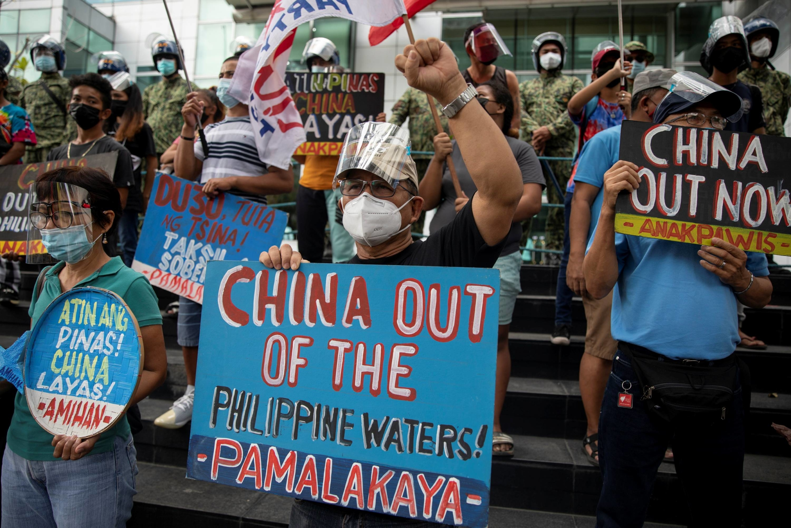 Activists stage a protest outside the Chinese Consulate on the fifth anniversary of an international court of arbitration ruling that invalidated Beijing's historical claims over the waters of the South China Sea, in Makati City, Philippines, on Monday.     REUTERS