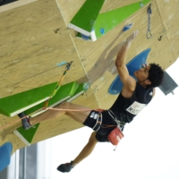 World champion Tomoa Narasaki is in contention to win the inaugural gold medal in men's sport climbing.   KYODO