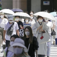People walk in Tokyo's Ginza shopping district on Friday. | KYODO