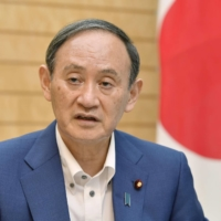 Prime Minister Yoshihide Suga speaks during an interview on Friday.  | KYODO