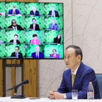 Prime Minister Yoshihide Suga attends an informal virtual meeting of the Asia-Pacific Economic Cooperation forum on Friday. | PRIME MINISTER'S OFFICE / VIA KYODO