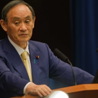 Prime Minister Yoshihide Suga pauses during a news conference in Tokyo on July 8. | SIPA / VIA BLOOMBERG