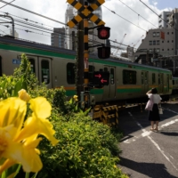 Tokyo reports 1,410 new COVID-19 cases, rising above 1,000 for fourth day