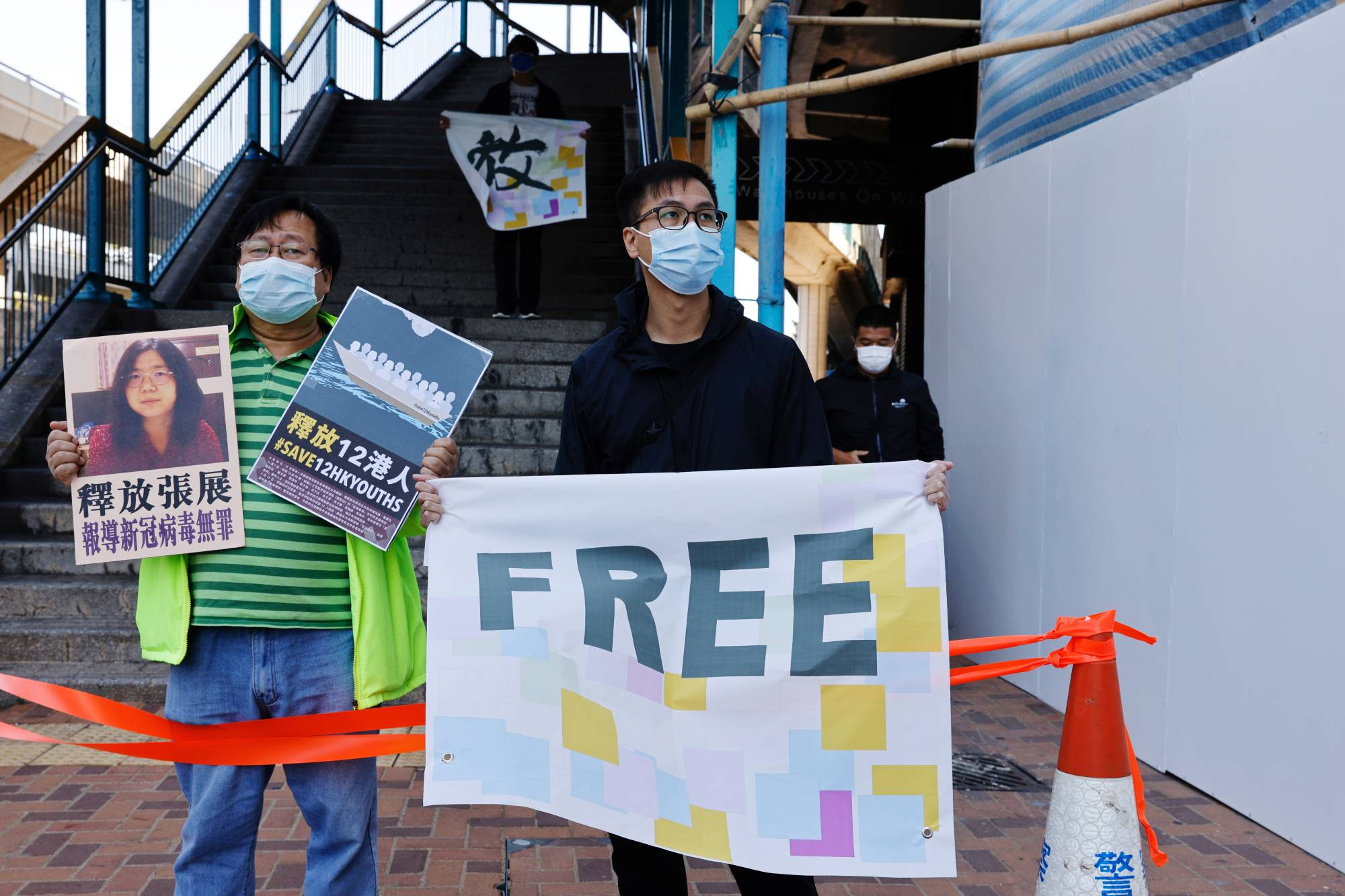Protesters demonstrate against the detention of pro-democracy activists in Hong Kong in December 2020.  | REUTERS