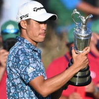 U.S. golfer Collin Morikawa poses for pictures after winning the British Open at Royal St George's, Sandwich, England, on Sunday. | AFP-JIJI