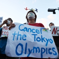 People protest against the Tokyo Olympic Games outside the Akasaka State Guest House, where International Olympic Committee President Thomas Bach attended a welcome ceremony on Sunday.